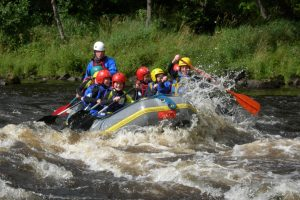 School group rafting river spey