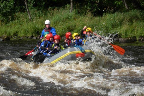 School group rafting river spey