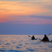Sea kayaking into the sunset