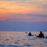 Sea kayaking into the sunset