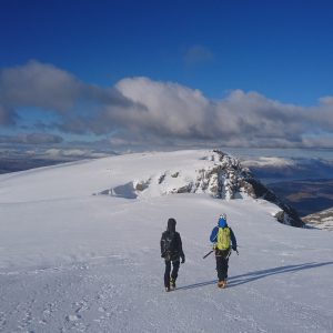 Walking off the summit of Ben Nevis in Winter