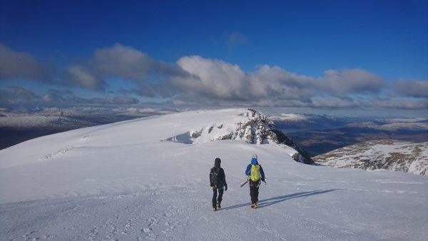Walking off the summit of Ben Nevis in Winter